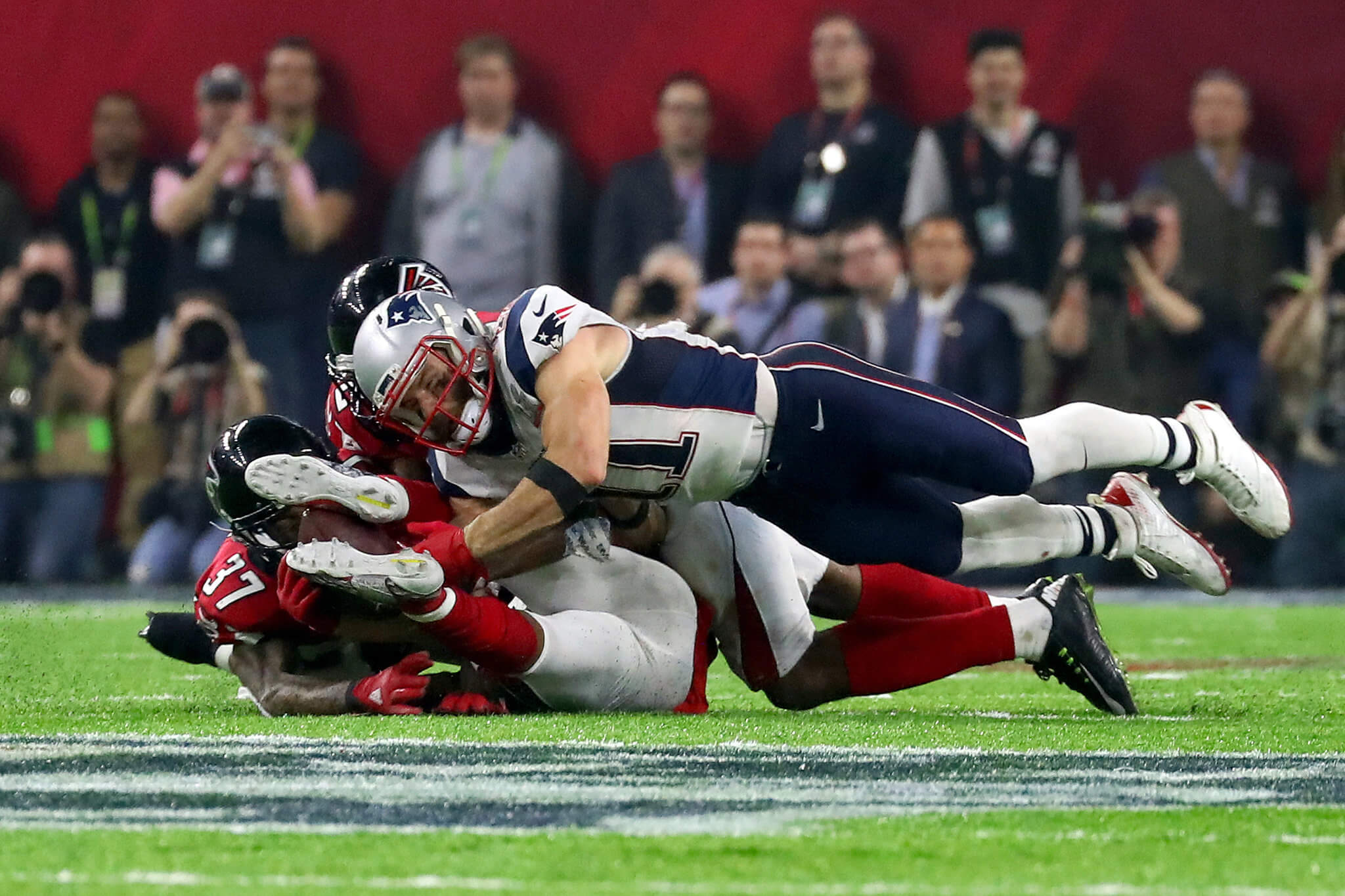 Receiver Julian Edelman improbably kept the ball off the ground long enough to complete a catch that kept the Patriots' game-tying drive alive.
