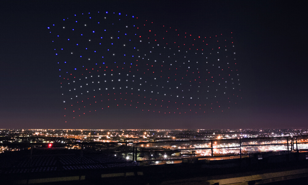 An army of drones form the United States flag in sky night sky above the NGR Stadium in Houston